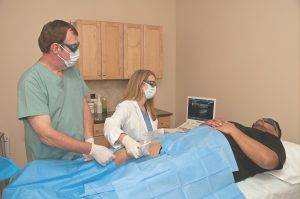 Dr. Kuefner performing vein treatment on a patient at the Vein Center of Orland PArk